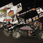 Brian Brown (21), Terry McCarl (24) and Christopher Bell battle three-wide for the race lead during Friday's Midwest Open Wheel Ass'n feature at Lincoln Speedway in Putnamville, Ind. (Mark Funderburk Photo)