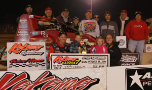 Jerry Coons Jr. stands in victory lane with his family and crew after winning the Kokomo Klash VII at Kokomo (Ind.) Speedway on Friday. (Gordon Gill Photo)
