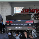 The crew works on the No. 88 Chevrolet of Dale Earnhardt Jr. during a driver test at Homestead-Miami Speedway in Homestead, Florida.