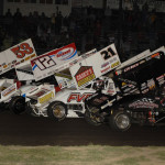 The Midwest Open Wheel Ass'n goes four-wide during a parade lap prior to the start of Friday's feature at Lincoln Speedway in Putnamville, Ind. (Mark Funderburk Photo)