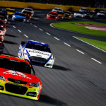 Jeff Gordon leads a pack of cars during a 2013 NASCAR Sprint Cup Series race at Charlotte Motor Speedway. (NASCAR Photo)