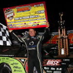 Scott Bloomquist celebrates his $25,000 victory in the National Dirt Racing League Pittsburgher 100 at Pittsburgh's Pennsylvania Motor Speedway on Saturday night. (Hein Brothers Photo)