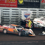 Safety workers work to clear a crash from the track during Saturday's Lucas Oil Late Model Knoxville Nationals. (Mike Reufer Photo)