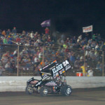 Terry McCarl crosses the finish line to win Friday's Midwest Open Wheel Ass'n race at Tri-State Speedway. (Don Figler Photo)