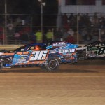 Jamie Lomax (36) and Jacob Poel (82) ran high and low in the closing laps of the UMP modified feature at Montpelier (Ind.) Speedway. (Gary Gasper photo)