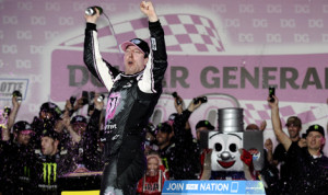 Kyle Busch celebrates in victory lane after his victory in Friday's Dollar General 300 at Charlotte Motor Speedway. (NASCAR Photo)