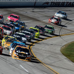 The NASCAR Sprint Cup Series field heads towards the start/finish line during Sunday's race at Talladega (Ala.) Superspeedway. (NASCAR Photo)