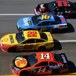 Austin Dillon (14), Joey Logano (22), Greg Biffle (16) and Denny Hamlin race four-wide during Sunday's NASCAR Sprint Cup Series race at Talladega (Ala.) Superspeedway. (NASCAR Photo)