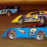 Battling it out three wide in the pro late model feature are Dusty Curry (8), Steve Beatty (b4), and Mark Moats (15) at Pittsburgh's Pennsylvania Motor Speedway. (Hein Brothers photo)