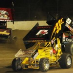 Daryn Pittman (9) and Bryan Sebetto (24) spin as Sheldon Haudenschild passes by on the lowside Saturday at Fremont (Ohio) Speedway. (Julia Johnson Photo)