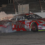 Clay Rogers celebrates with a burnout after winning Saturday's X-1R Pro Cup Series race at Hickory (N.C.) Motor Speedway. (Adam Fenwick Photo)