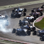 Smoke billows out from one of several Formula One cars flowing through a turn at the Suzuka Circuit on Sunday. (Steve Etherington Photo