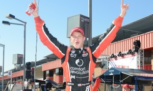 Sage Karam celebrates winning the Firestone Indy Lights championship. (Al Steinberg photo)