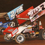 Jason Sides (7s) works under Dale Blaney during Friday's World of Outlaws STP Sprint Car Series race at Williams Grove Speedway. (Julia Johnson Photo)