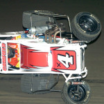 Dave Camfield Jr. flipped his midget during Gold Crown Midget Nationals heat race action Thursday at Tri-City Speedway. (Don Figler Photo)