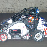 Brady Bacon (11) and Shane Cottle lead the Gold Crown Midget Nationals field to the green flag Thursday at Tri-City Speedway. (Don Figler Photo)