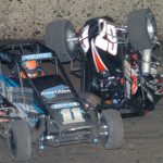 Andrew Felker (11) and Tanner Thorson crash during Thursday's Gold Crown Midget Nationals feature at Tri-City Speedway. (Don Figler Photo)