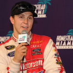 Trevor Bayne chats with the media after testing his No. 21 Ford Fusion at Homestead-Miami Speedway in Homestead, Florida.