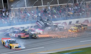Miguel Paludo flips through there air as trucks crash in every direction on the final lap of Saturday's NASCAR Camping World Truck Series race at Talladega (Ala.) Superspeedway. (HHP/Harold Hinson photo)