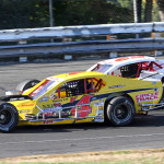 Donny Lia (4) passes Doug Coby on his way to victory in Sunday's NASCAR Whelen Modified Tour race at Stafford Motor Speedway. (Dick Ayers Photo)