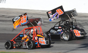 Randy Cabral (47) battles John Zych Jr. during last Sunday's Northeastern Midget Ass'n feature at Thompson Int'l Speedway. (John DaDalt Photo)