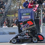 John Zych Jr. crosses the finish line to win Sunday's NEMA Midget feature at Thompson Int'l Speedway. (Dick Ayers Photo)