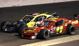 George Brunnhoelzl III (28) battles alongside Andy Seuss during a recent NASCAR Whelen Southern Modified Tour race. (NASCAR Photo)