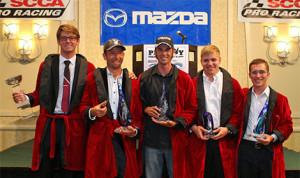 (l-r) Kenton Koch, Christian Szymczak, John Dean, Patrick Gallagher and Elliott Skeer show off their trophies adorned in Playboy Hugh Heffner-style smoking jackets. (Photo: Alison Merion Padron)