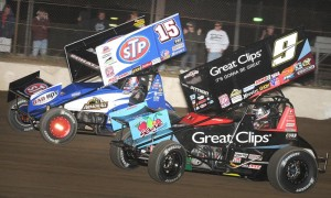 Donny Schatz (15) and Daryn Pittman battle during World of Outlaws STP Sprint Car Series action at Fremont (Ohio) Speedway. (Frank Smith Photo)