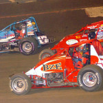Vern Sweeney (98), Bud Kaeding (29) and Danny Faria Jr. battle during Friday's AMSOIL USAC National Sprint Car Series event at Perris (Calif.) Auto Speedway.