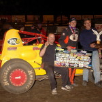 Enjoying victory lane after winning the USAC sanctioned 360 Sprint Nationals at Perris Auto Speedway are (left to right) crew Randy Dertig, driver Mike Spencer, owner Mark Priestley, and crew Jason Dertig (Photo: Hein Brothers)