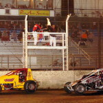 Mike Spencer (7) holds off hard charging Bryan Clauson (16) while charging towards the white flag during the USAC sanctioned 360 Sprint Nationals at Perris Auto Speedway.  Spencer goes on to lead the final lap winning the event while Clauson jumped the cushion and tag the wall falling to a 12th place finish. (Photo: Hein Brothers)