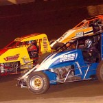 Andrew Reinbold (19), Cory Kruseman (7) and Chris Gansen battle during the Budweiser Oval Nationals Saturday at Perris (Calif.) Auto Speedway. (Hein Brothers Photo)