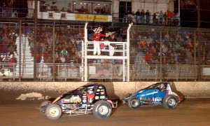 Dave Darland beats Bryan Clauson to the finish line to win the Budweiser Oval Nationals last November. (Hein Brothers Photo)