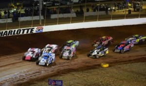 Super DIRTcar Series modifieds roll to the start of a heat race during the opening night of the World of Outlaws World Finals Thursday at The Dirt Track at Charlotte. (CMS photo)