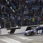 Jimmie Johnson takes the checkered flag to win the AAA Texas 500 at Texas Motor Speedway in Fort Worth, Texas. (HHP/Harold Hinson)