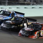 James Busescher, Nelson Piquet Jr. and Brennan Newberry race during the Ford 200 at Homestead Miami Speedway in Homestead, FL. (HHP/Christa L Thomas)