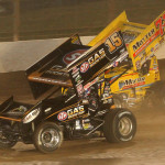 Donny Schatz (15) battles by Joey Saldana during Friday's World of Outlaws STP Sprint Car Series event at The Dirt Track at Charlotte Motor Speedway. (Dick Ayers Photo)