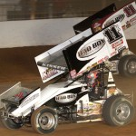 Kraig Kinser (11k) battles alongside his father Steve Kinser during World of Outlaws STP Sprint Car Series action at The Dirt Track at Charlotte last weekend. (Dick Ayers Photo)
