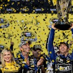 Jimmie Johnson celebrates in Champions Victory Lane after winning the series championship following the NASCAR Sprint Cup Series Ford EcoBoost 400 at Homestead-Miami Speedway in Homestead, Florida. (Photo by Robert Laberge/Getty Images)