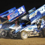 Rico Abreu (24) and Keith Day prepare for a restart during the Gary Patterson Memorial event at the Stockton (Calif.) Dirt Track. (Tom Parker Photo)