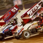 Jason Sides (7s) battles Paul McMahan for the race lead during Saturday's World of Outlaws STP Sprint Car Series feature at The Dirt Track at Charlotte Motor Speedway. (Dave Dalesandro/MSI Photo)