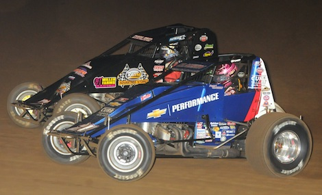 Bryan Clauson (20) and Dave Darland battle for the lead during Saturday's Oval Nationals at Perris Auto Speedway. (Ken Simon photo)
