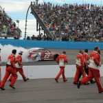 The Budweiser team heads toward victory lane as driver Kevin Harvick celebrates his Advocare 500 win at Phoenix International Raceway in Avondale, AZ. (Photo: Al Munger)