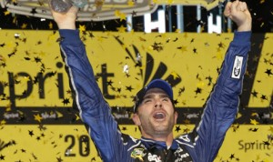 Jimmie Johnson celebrates after clinching his sixth NASCAR Sprint Cup Series championship on Sunday. (HHP/Harold Hinson Photo)
