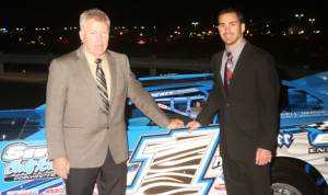 2013 World of Outlaws Late Model Series champion Josh Richards (right) and his father/car owner Mark Richards pose with their car prior to the tour's awards banquet on Sunday night at the Great Wolf Lodge in Concord, N.C. (Barry Lenhart photo)