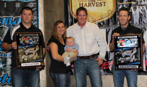 Jason Johnson is joined by his wife, child, and crew as the 2013 Lucas Oil ASCS National Champion.(ASCS/Bryan Hulbert)