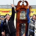 Jimmie Johnson celebrates in victory lane with team owner Rick Hendrick after winning the NASCAR Sprint Cup Series STP Gas Booster 500 at Martinsville Speedway in 2013. (NASCAR Photo)