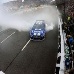 Jimmie Johnson celebrates with a burnout after winning the NASCAR Sprint Cup Series STP Gas Booster 500 at Martinsville Speedway in Ridgeway, Virginia. (Photo by Jared C. Tilton/NASCAR via Getty Images)