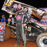 Donny Schatz stands in victory lane after winning his 23rd World of Outlaws STP Sprint Car Series feature of 2013 on Friday at The Dirt Track at Charlotte Motor Speedway. (Justin Leedy Photo)